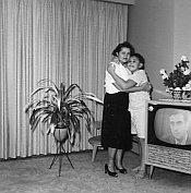 No one's hugging the poor TV set.
